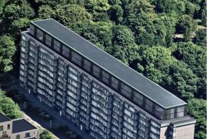 De två skivhusen i öster planeras att byggas på med två våningar.